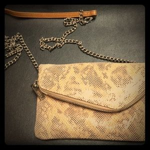 Hobo fold over clutch purse with detachable chain.